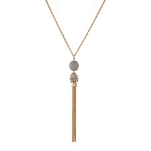 "Gold tone necklace featuring a gray natural stone pendant and chain tassel. Approximately 30"" in length."
