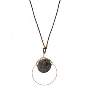 "Gray leather cord necklace featuring an open gold tone circle pendant with a labradorite natural stone. Approximately 32"" in length."