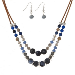 "Brown cord, two layer, necklace set featuring blue and sodalite natural stone beads and matching fishhook earrings. Approximately 14"" and 16"" in length."