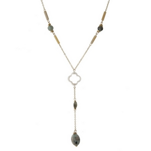 "Dainty gold tone 'Y' necklace featuring mint and neutral colored stones and a clover focal. Approximately 14"" in length."