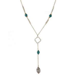 "Dainty gold tone 'Y' necklace featuring turquoise and opal colored stones and a clover focal. Approximately 14"" in length."