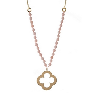 "Gold tone necklace featuring rose quartz natural stone beads and an open clover pendant. Approximately 32"" in length."