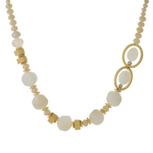"Gold tone necklace featuring opal, ivory and topaz beads. Approximately 16"" in length."