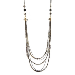 "Gray and gold tone necklace featuring layers of gray and opal beads. Approximately 34"" in length."