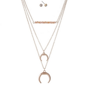 "Dainty rose gold tone, three row necklace set featuring peach beads, a crescent pendant, and clear rhinestone pendants. Approximately 14"" to 18"" in length."