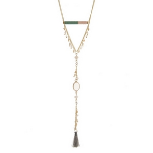 "Gold tone necklace with a sage green and light pink thread wrapped bar and a fabric tassel pendant. Approximately 28"" in length."