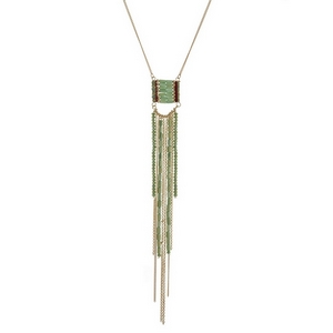 "Gold tone necklace with a green beaded tassel pendant. Approximately 30"" in length."