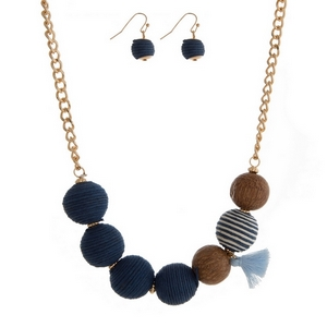 "Gold tone necklace set navy blue thread wrapped balls and a tassel accent. Approximately 16"" in length."