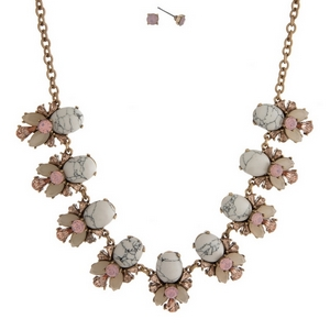 "Gold tone necklace set with howlite stones, accented with pink and ivory rhinestones and matching stud earrings. Approximately 16"" in length."