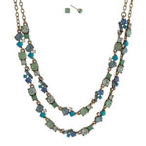 "Burnished gold tone necklace set with two layers of mint green, blue and turquoise rhinestones and matching stud earrings. Approximately 16"" in length."