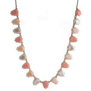 "Burnished gold tone necklace with peach, blush pink and taupe faceted stones. Adjustable from 12"" to 32"" in length."