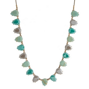 "Burnished gold tone necklace with turquoise, mint green and gray faceted stones. Adjustable from 12"" to 32"" in length."