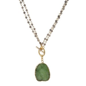 """Gold tone and gray beaded toggle necklace featuring a green druzy stone pendant. Can we worn long or short by undoing the front toggle. Approximately 16"""" or 36"""" in length. Handmade in the USA."""