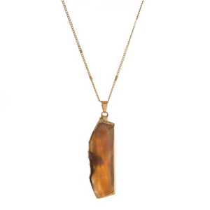 "Gold tone necklace featuring a gray natural stone pendant. Approximately 32"" in length."