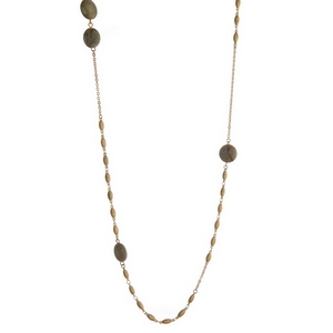 "Gold tone necklace featuring gray natural stones. Approximately 38"" in length."