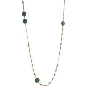 "Gold tone necklace featuring turquoise natural stones. Approximately 38"" in length."