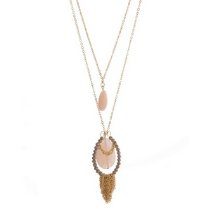 "Gold tone two layer necklace featuring two rose quartz natural stones, gray faceted beads and chain fringe. Approximately 21"" and 28"" in length."