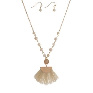 "Gold tone necklace set featuring freshwater pearl beads, a beige fabric tassel pendant and matching fishhook pendant. Approximately 22"" in length."