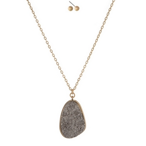 "Gold tone necklace set featuring a gray faux druzy stone pendant and matching stud earrings. Approximately 17"" in length."