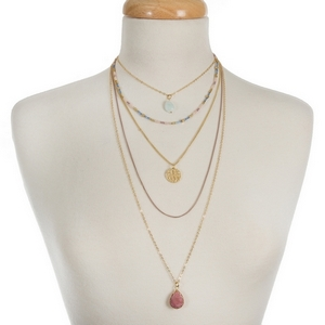 """Gold tone, multi layer necklace with champagne, blue and pink beads. Approximately 14"""" to 30"""" in length."""