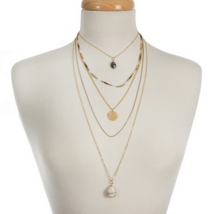 "Gold tone, multi layer necklace with champagne, tan and bronze beads. Approximately 14"" to 30"" in length."
