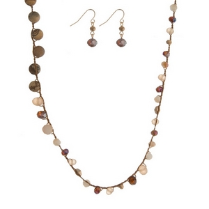 "Brown cord toggle necklace featuring ivory and brown faceted beads, picture jasper natural stone beads, and a gold tone toggle closure. Approximately 18"" in length."