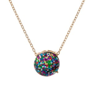 "Gold tone necklace with a multi colored glitter, circle pendant. Approximately 16"" in length."