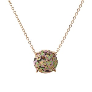 "Gold tone necklace with a pink and green glitter, circle pendant. Approximately 16"" in length."
