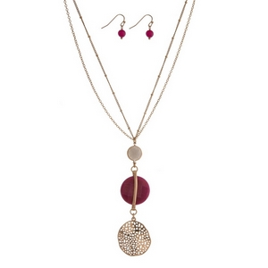 "Gold tone necklace with a fuchsia and gray stone pendant and matching fishhook earrings. Approximately 30"" in length."