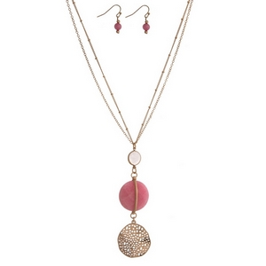 "Gold tone necklace with a pink and white stone pendant and matching fishhook earrings. Approximately 30"" in length."