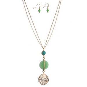 "Gold tone necklace with a turquoise and mint green stone pendant and matching fishhook earrings. Approximately 30"" in length."