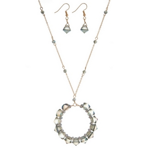 """Gold tone necklace set with a green beaded circle pendant and matching fishhook earrings. Approximately 32"""" in length."""
