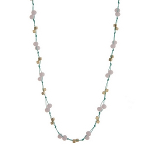 "Mint green cord necklace with pale pink faceted beads and gold tone accents. Approximately 32"" in length."