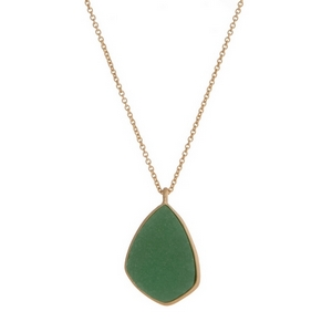 "Gold tone necklace with a green faux druzy stone pendant. Approximately 29"" in length."