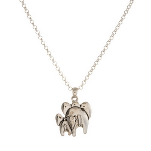 "Silver tone necklace set with a two elephant pendant. Approximately 16"" in length."