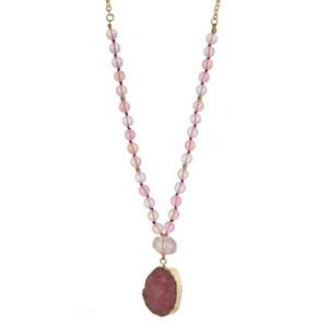 "Gold tone necklace with pink iridescent beads and a pale pink druzy stone pendant. Approximately 28"" in length. Handmade in the USA."