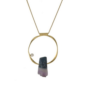 """Gold tone necklace with a circle pendant and purple crystal stone. Approximately 32"""" in length."""