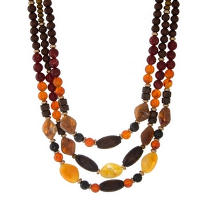 """Burgundy, brown and wooden beaded necklace with three layers. Approximately 16"""" to 18"""" in length."""