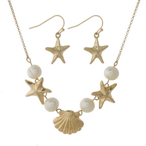 """Gold tone necklace set with freshwater pearl beads, starfish, seashells and matching fishhook earrings. Approximately 16"""" in length."""