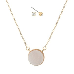 "Gold tone necklace set with an ivory faux druzy circle stone pendant and matching stud earrings. Approximately 16"" in length."