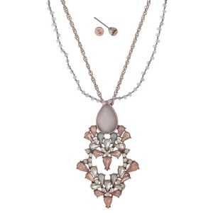 "Rose gold tone necklace set with a pink and opal rhinestone pendant and beaded accents. Approximately 18"" in length."