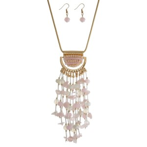 "Gold tone necklace set with a pale pink, opal and ivory beaded tassel pendant and matching fishhook earrings. Approximately 28"" in length."