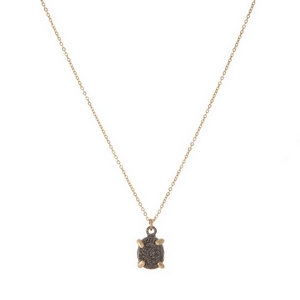 "Dainty gold tone necklace with a gray druzy stone pendant. Approximately 16"" in length."