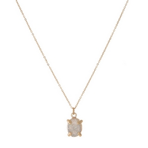 "Dainty gold tone necklace with a white iridescent druzy stone pendant. Approximately 16"" in length."