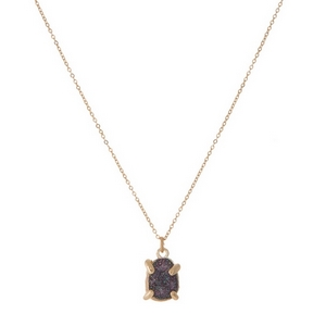 "Dainty gold tone necklace with a navy blue druzy stone pendant. Approximately 16"" in length."