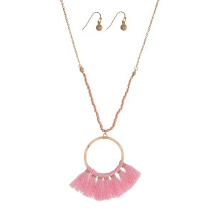 "Gold tone necklace set with an open circle pendant and pink fabric tassels. Approximately 30"" in length."