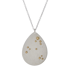 """Silver tone necklace with a two tone pendant and gold beads. Approximately 32"""" in length."""