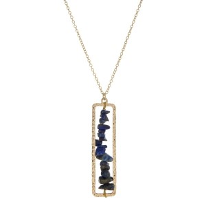 """Gold tone necklace with a sodalite chip stone pendant. Approximately 32"""" in length."""