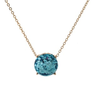 "Gold tone necklace with an aqua glitter, circle pendant. Approximately 16"" in length."