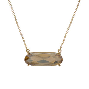 """Dainty gold tone necklace with a topaz rhinestone pendant. Approximately 16"""" in length."""